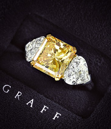 6.70ct Fancy Vivid Orangy Yellow Diamond Ring